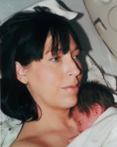 Tracey nuzzling her sweet little one after their natural hospital birth