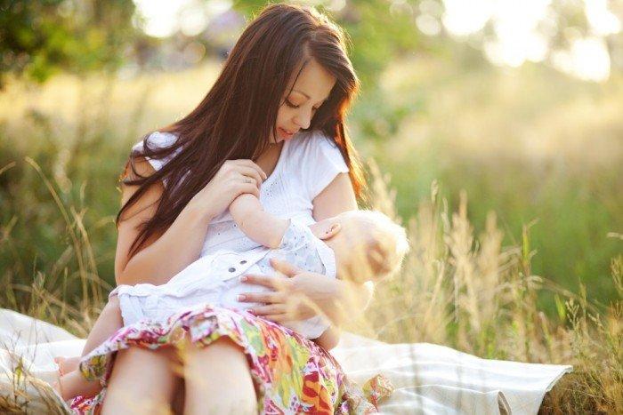 Beautiful outdoor breastfeeding shot