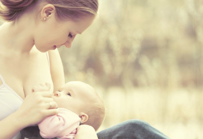 Teen mom breastfeeding